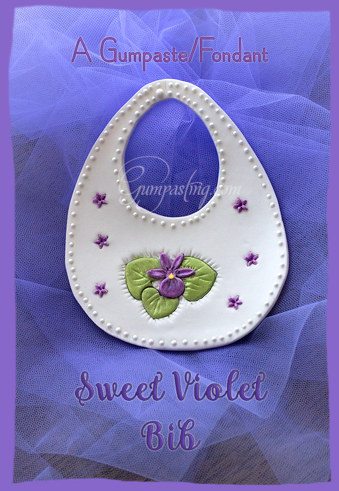 {A Gumpaste/Fondant Baby Bib with a Sweet Violet Flower}